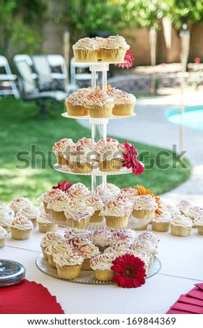 a tablle full of cupcakes with a blurred background - stock photo