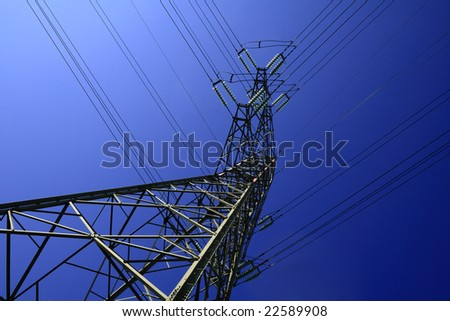 A tall electric pillar in the blue sky - stock photo