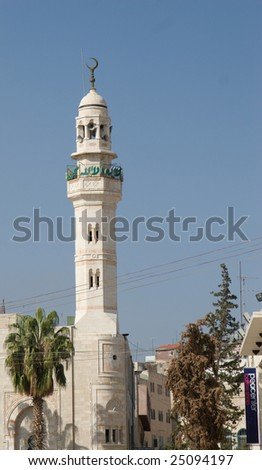 A tall minaret stands in Manger Square in Bethlehem