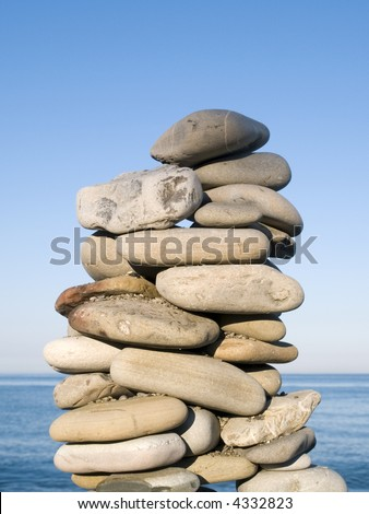 A tall pile of rocks stacked on the beach