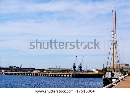 A tall ship moored in the Port River at Port Adelaide, with the new Derrik Diver bridge in the background. - stock photo