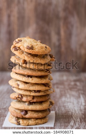 A tall stack of chocolate chip cookies for dessert - stock photo