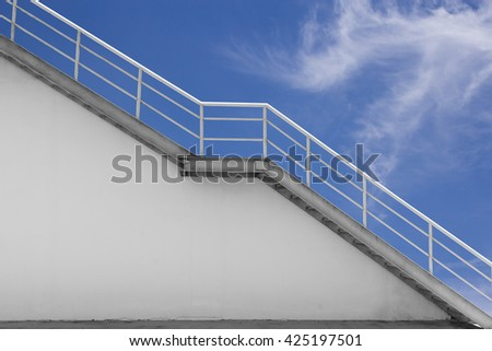 A tall white straight staircase stretches to infinity on a bright sky.Concepts Progress life.Concepts of overcoming obstacles. - stock photo