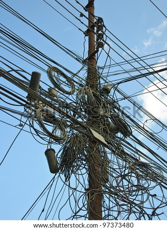 A tangle of cables and wires in Kathmandu, Nepal - stock photo