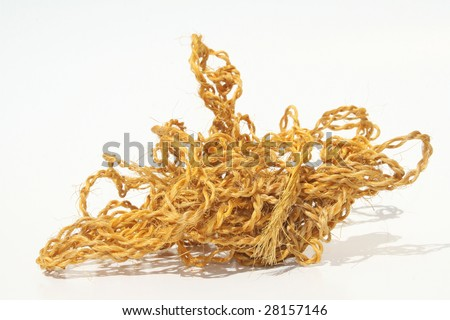 A tangled ball of twine on white background - stock photo