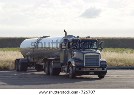 A tank truck in a parking lot. - stock photo