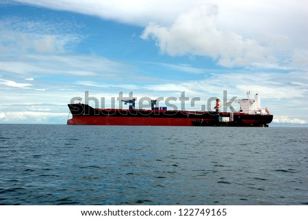a tanker is anchored in the middle of the ocean - stock photo