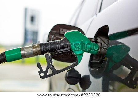 a tap for gasoline at a gas station. refuel a car - stock photo