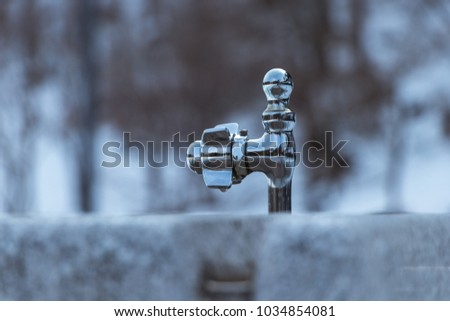 a tap. water. steel. background