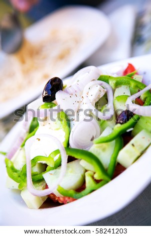A tasty and healthy feta cheese salad at a Greek restaurant. - stock photo