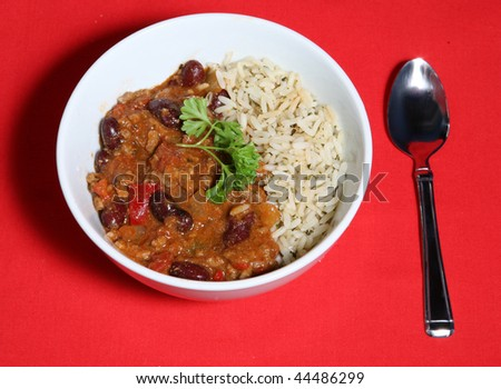 A tasty meal of Chilli con Carne served with Saffron rice - stock photo