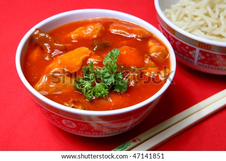 A tasty meal of sweet and sour pork with rice - stock photo