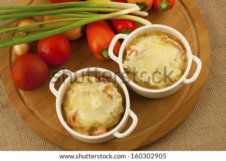 a tasty small stew with tomato  served on the table ready to eat - stock photo