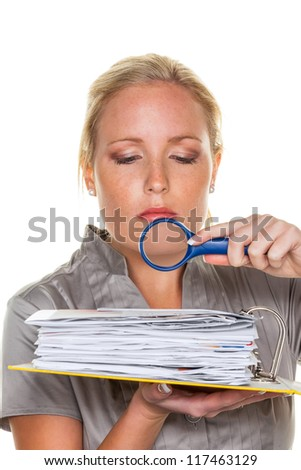 a tax auditor from the tax office at work. controller scanned documents - stock photo