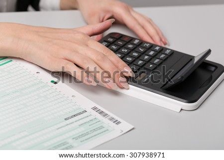 a tax declaration form and a calculator