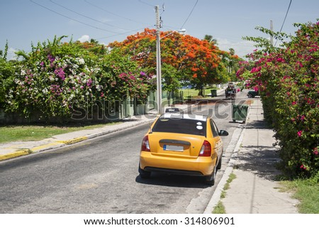 A taxi waits for fares on a side street in Varadero, Cuba. - stock photo