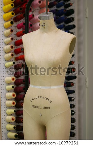 a taylors mannequin with the workshop in the background - stock photo