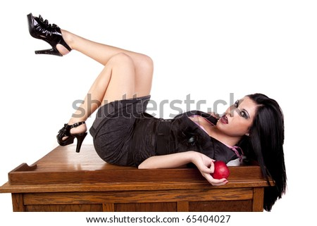 A teacher is laying on her desk. - stock photo