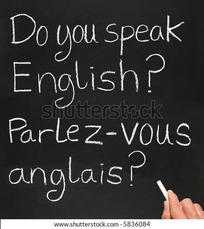 A teacher writing do you speak english in French. - stock photo