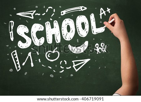 A teacher writing school, drawing children things on clean green chalkboard by hand - stock photo