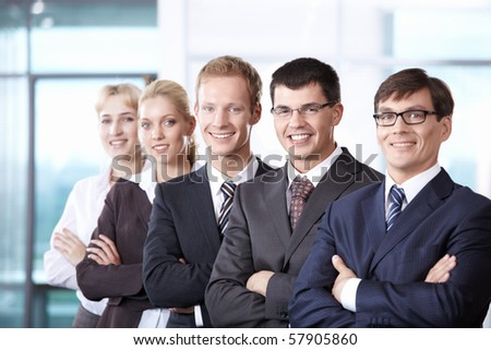 A team is shoulder to shoulder in the office - stock photo