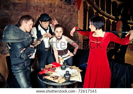 a team of adventurers is making plans, at the taverns table - stock photo