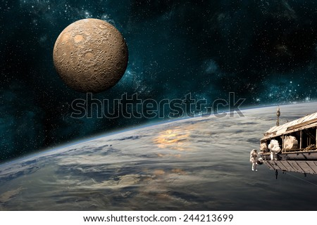 A team of astronauts work on a space station in orbit. An Earth-like planet sees the glow of its sun while a heavily cratered moon rises in the background. Elements of this Image Furnished by NASA. - stock photo