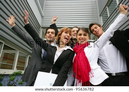 A team of motivated and dynamic office workers - stock photo