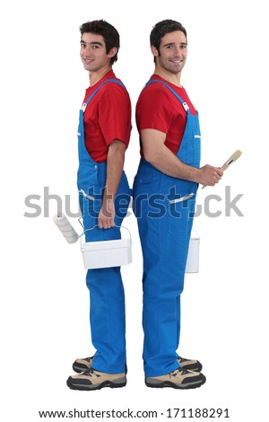 A team of painters standing back-to-back - stock photo