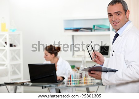 A team of researchers working in a laboratory - stock photo