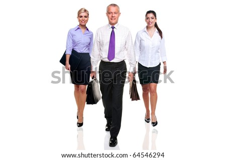A team of three business people walking towards camera, isolated on a white background. - stock photo