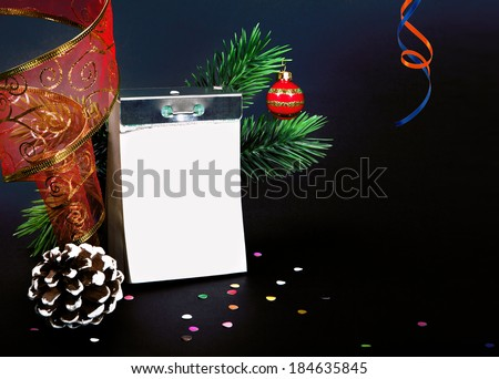 A tear-off calendar with Christmas decorations on a black background - stock photo