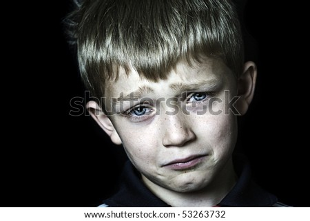 a tearful and miserable blonde child - stock photo