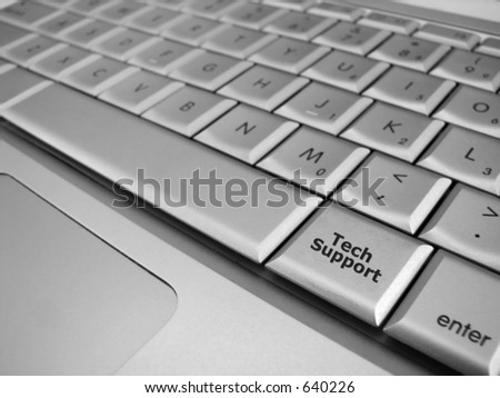 A Tech Support key in focus with all the surrounding keys out of focus - stock photo