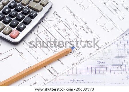 a technical design with a pencil and a calculator