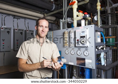 A Technician inspecting heating system in boiler room