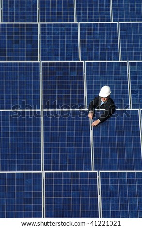 a technician works on a solar collector - stock photo