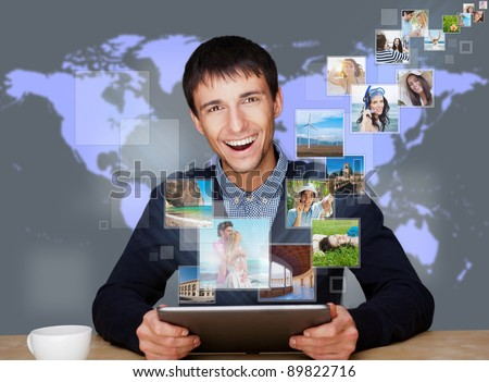 A technology man has images flying away from his modern tablet computer. Designed poster for a communication, social media sharing or tv concept.