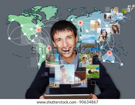 A technology man has images flying away from his modern tablet computer, He is at home. Designed poster for a communication, social media sharing or tv concept. - stock photo