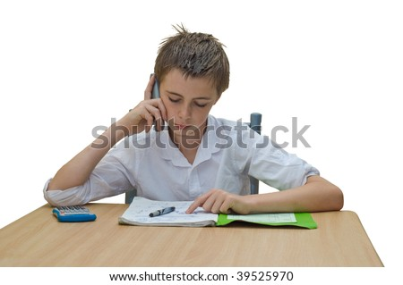 a teen boy studying and getting help from someone on the phone.