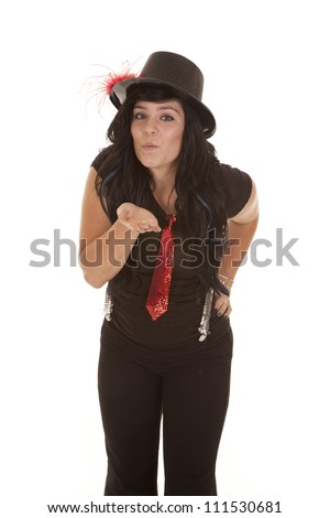 A teen girl blowing a kiss in her jazzy outfit. - stock photo