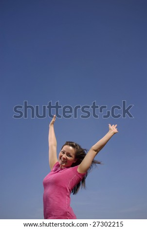 A teen girl celebrates a cloudless sky.