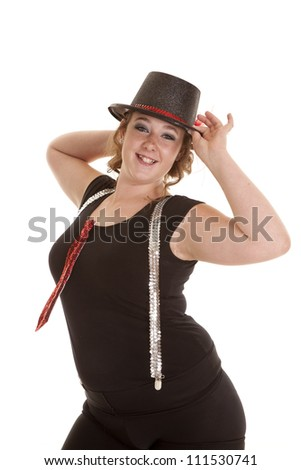 a teen girl showing her style holding on her top hat in her tie and suspenders - stock photo