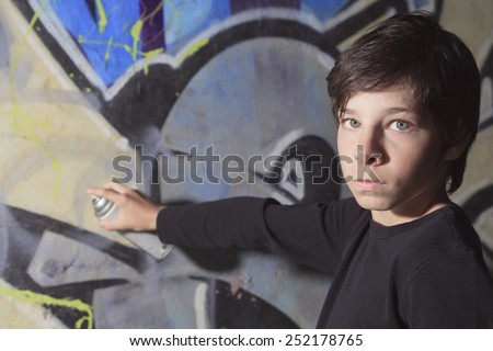 A teen made some graffiti on the wall of a tunnel - stock photo
