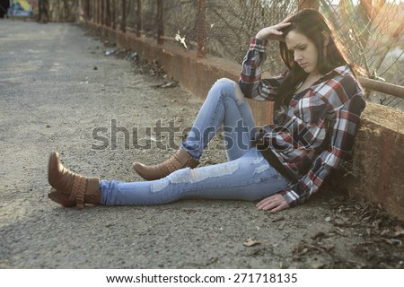 A teen siting on the ground like depress - stock photo