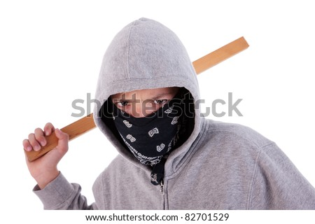 A teen with a stick, in a act of juvenile delinquency, in white background, studio session - stock photo