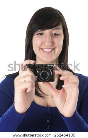 A teen with photo camera in studio white background