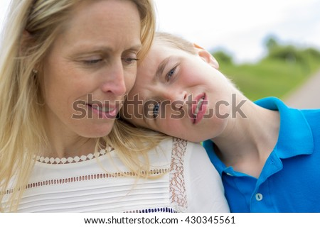 A teen with son head on the shoulder - stock photo