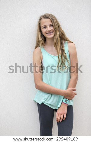 A teenage blonde model posing outdoors  - stock photo