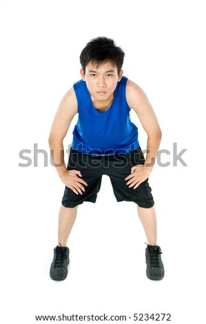 A teenage boy in blue sports vest and shorts on white background